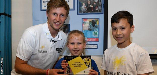 Joe Root meets pupils from his former school, Dore Primary School, in Sheffield