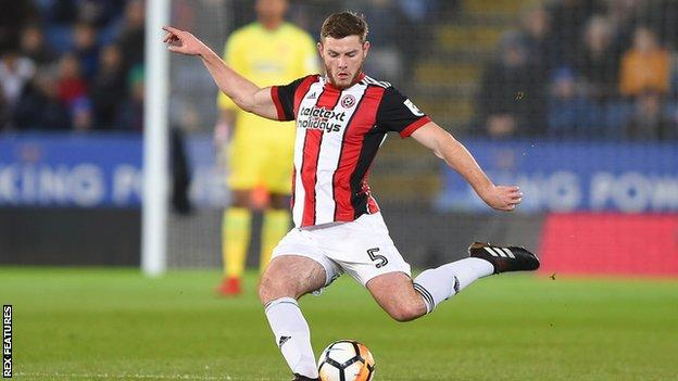 Jack O'Connell strikes the ball