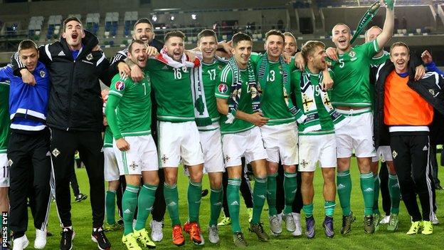 Northern Ireland players take the acclaim of their supporters after beating Greece 3-1 at Windsor Park