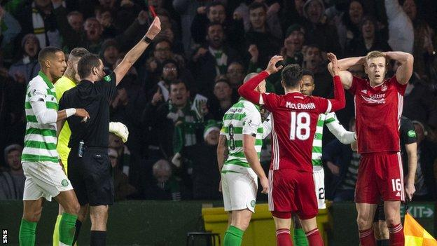 Aberdeen striker Sam Cosgrove (right) was sent off for a challenge on Celtic's Kristoffer AJer
