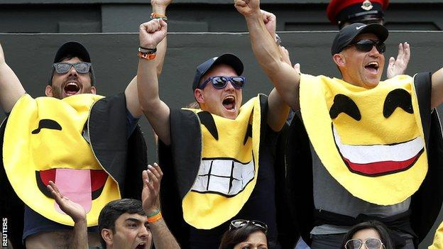 Some fans supporting James Ward dressed as emoticons for his match against Novak Djokovic