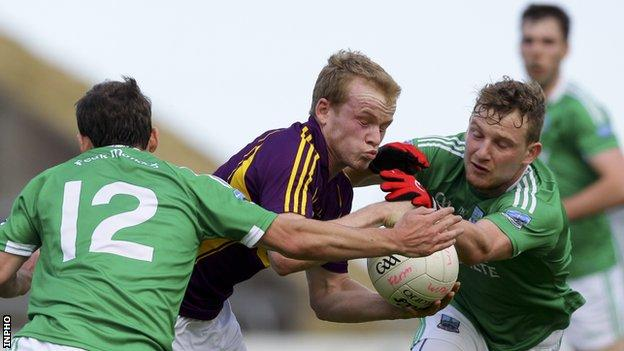 Fermanagh pair Paul McCusker and Aidan Breen challenge Wexford's Simon Donohoe