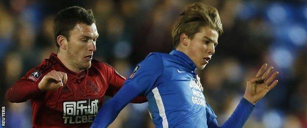 Peterborough midfielder Martin Samuelsen (right) and West Brom's Craig Gardner