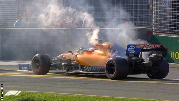 Smoke comes out of Carlos Sainz's McLaren