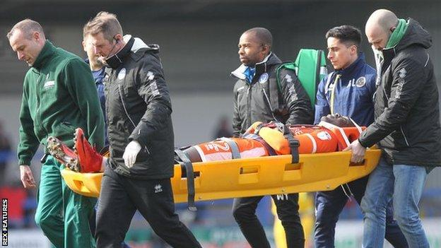 Toto Nsiala was stretchered off in the Good Friday defeat at Rochdale