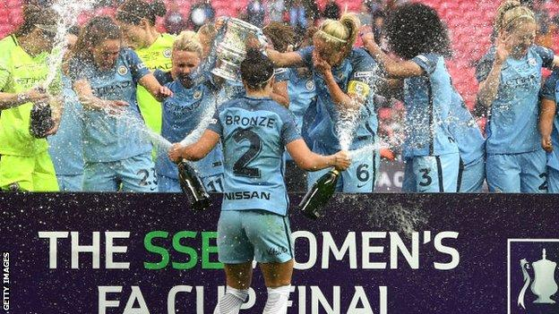 Lucy Bronze celebrating with Manchester City team-mates after winning the Women's FA Cup in 2017