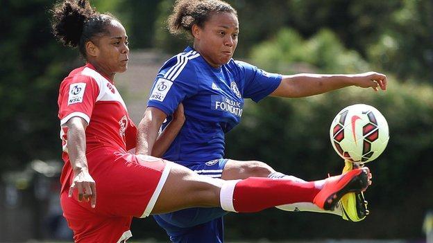 Jade Boho Sayo (l) takes on Chelsea's Drew Spence