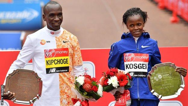 2019 London Marathon winners Eliud Kipchoge (left) and Brigid Kosgei (right) pose with their trophies