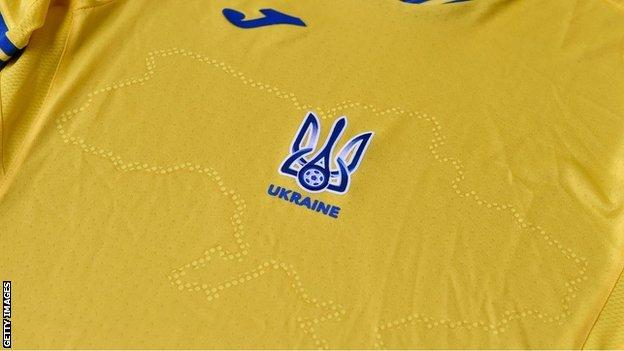 Ukraine's shirt, emblazoned with its borders including Russian-annexed Crimea