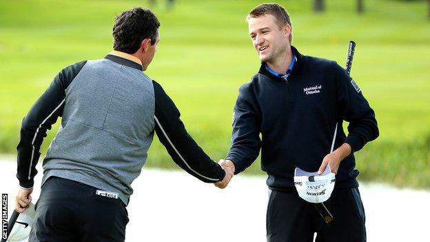 Russell Knox (right) shakes hands with Rory McIlroy after their final round at the Irish Open