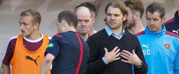 Hearts manager Robbie Neilson (centre right)