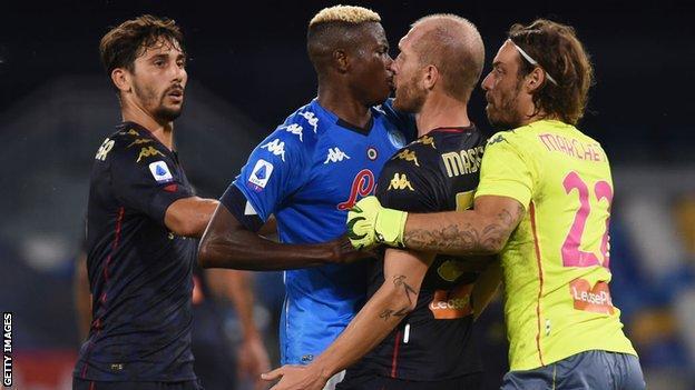 Genoa and Napli players clash