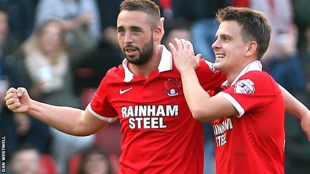 Sammy Moore (left) celebrates his second goal