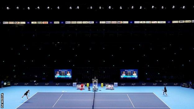 The empty O2 Arena as Dominic Thiem and Stefanos Tsitsipas take part in a rally