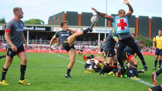 Rhys Webb clears during open training