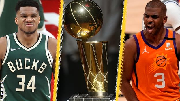 Giannis Antetokounmpo (left) and Chris Paul (right) next to the Larry O'Brien trophy