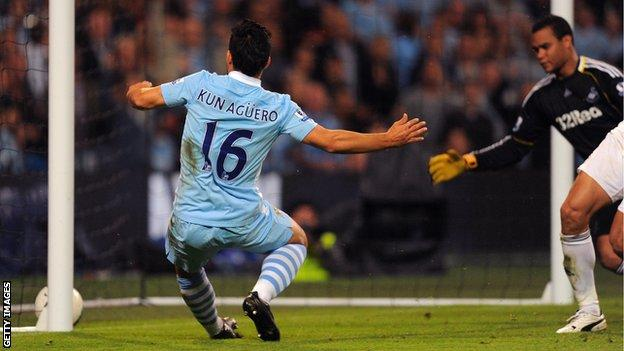 Manchester City's Sergio Aguero taps in the back post against Swansea