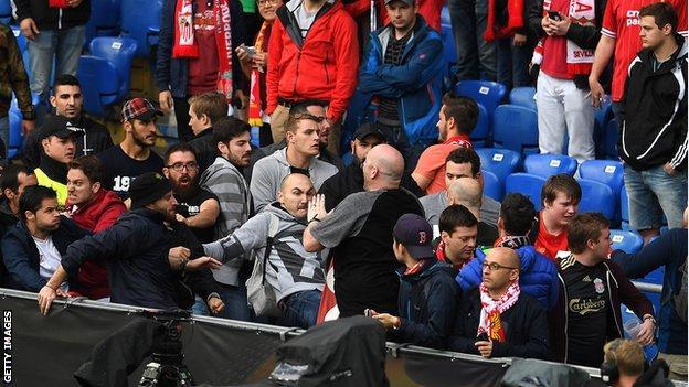 Liverpool and Sevilla fans clash