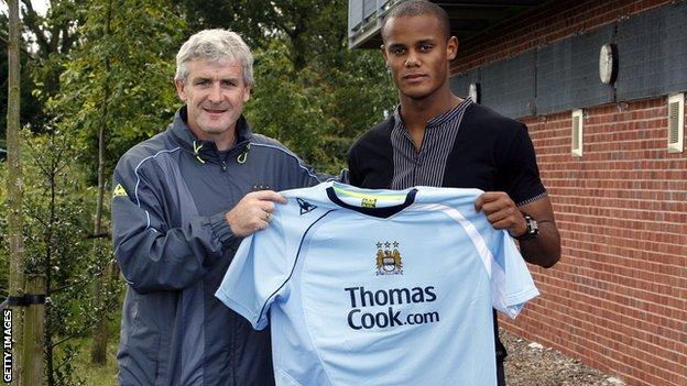 Manchester City Vincent Kompany with manager Mark Hughes