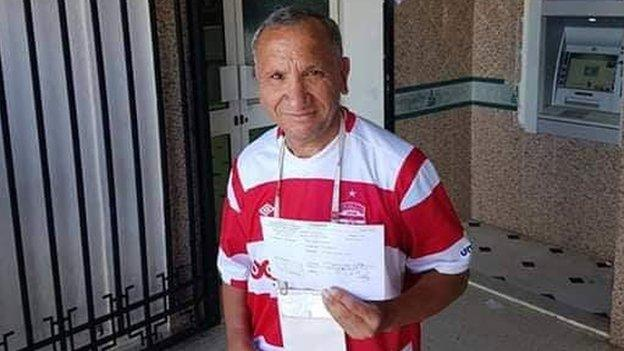 A Club Africain fan after donating to the team