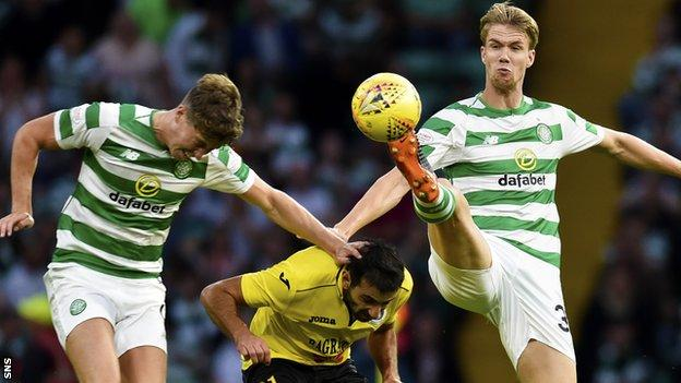 Celtic's Kristoffer Ajer tips the ball past team mate Jack Hendry and Alashkert's Artak Grigoryan