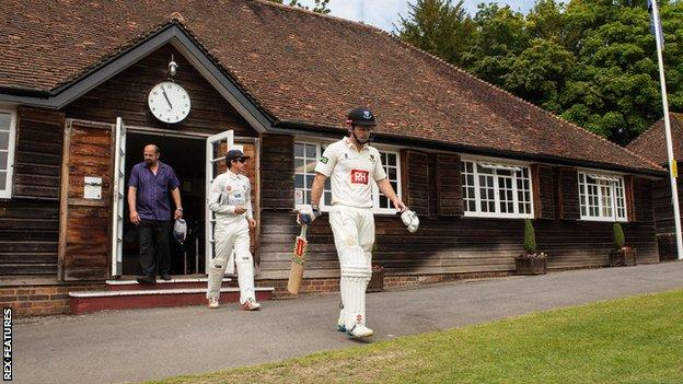 Ed Joyce emerges from the pavilion at Arundel Cricket Ground