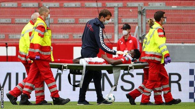 Nigeria's Taiwo Awoniyi being stretchered off with a head injury