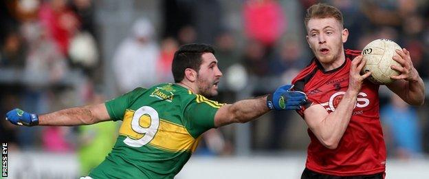 Down's Gerard McGovern tries to get past Kerry's Bryan Sheehan
