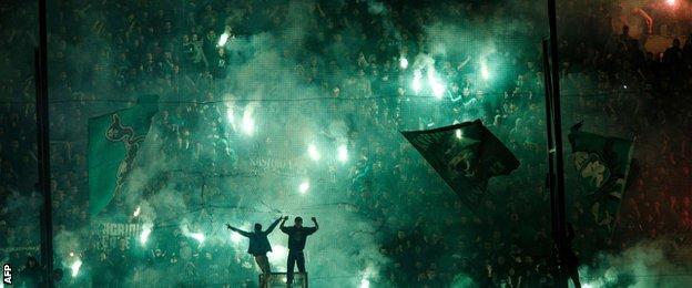 Panathinaikos fans light flares at the Apostolos Nikolaidis Stadium