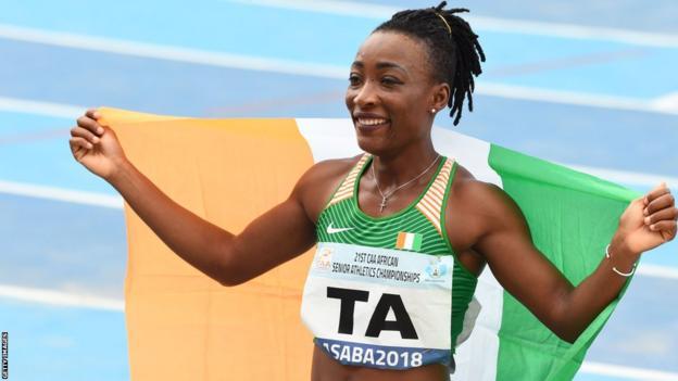 Ivorian sprinter Marie-Josee Ta Lou celebrates winning the 200m at the 2018 African Athletics Championships in Asaba, Nigeria