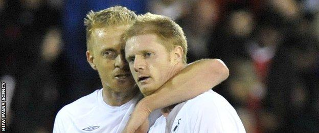 Garry Monk and Alan Tate as Swansea players in 2011