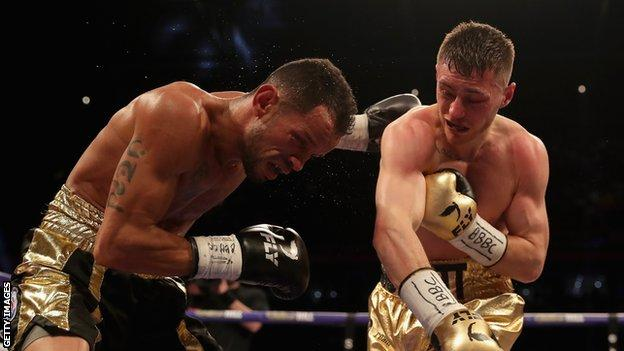 Ryan Burnett punches Yonfrez Parejo during their WBA Bantamweight Championship title fight at Principality Stadium