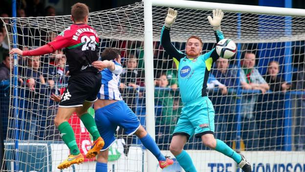 Glentoran's Conor McMemamin leaps highest to head across goal in the Showgrounds encounter against Coleraine