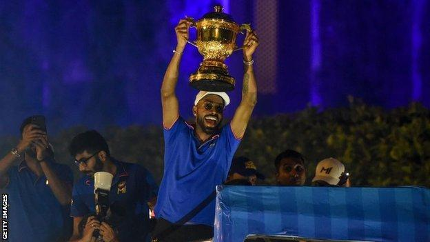 Hardik Pandya and his fellow Mumbai Indians players paraded the IPL trophy on a bus after winning the tournament in 2019