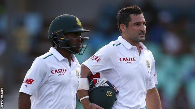 South Africa batsmen Temba Bavuma (left) and Dean Elgar (right) walk off at the end of a day's play in a Test match