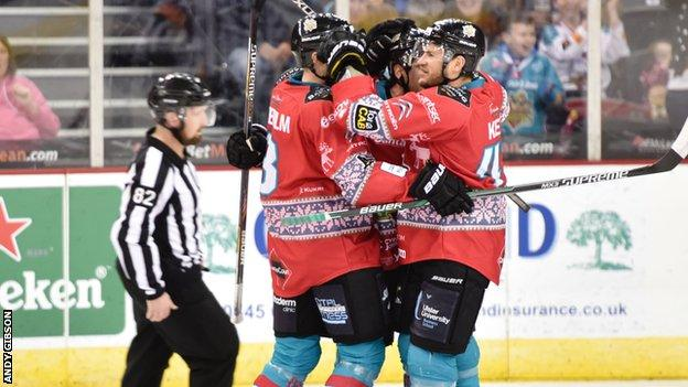 Belfast Giants celebrate scoring one of their two goals against Cardiff Devils