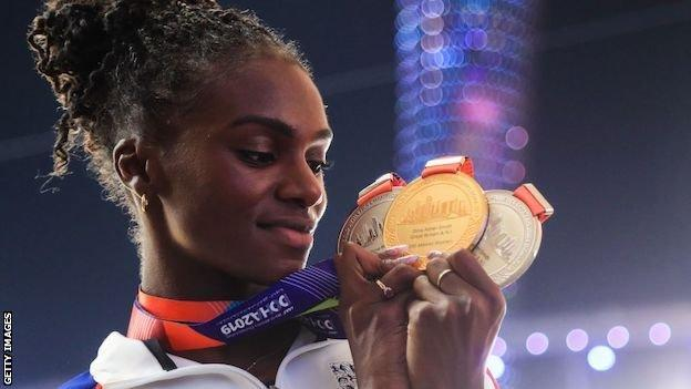 Dina Asher-Smith with her three World Championship medals in Doha in 2019