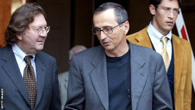 Banned doctor Michele Ferrari (centre) leaves court in Italy in 2004
