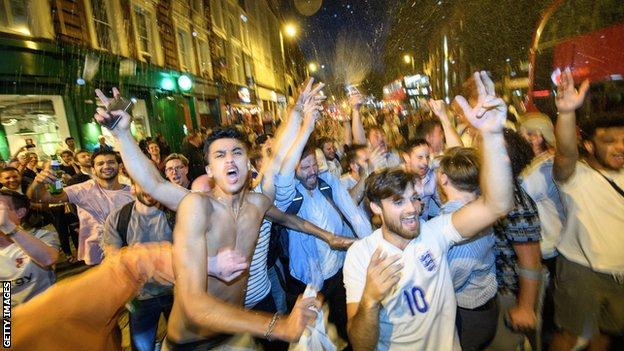 England fans celebrate victory over Colombia in London