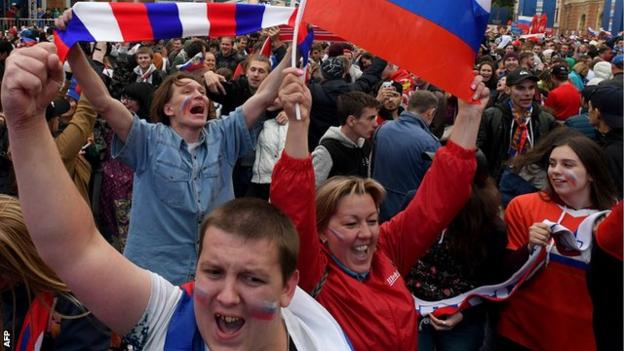 Russian football fans celebrate their teams win over Spain