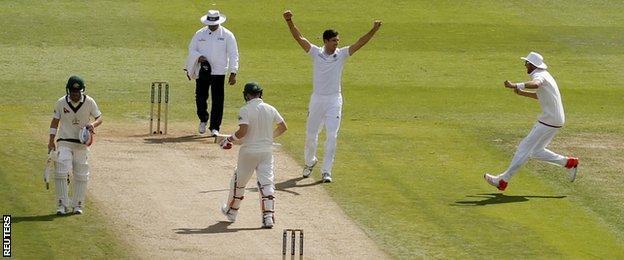 Steven Finn celebrates the wicket of Steve Smith