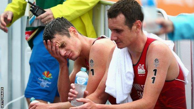 The Brownlee brothers looking dejected post-race