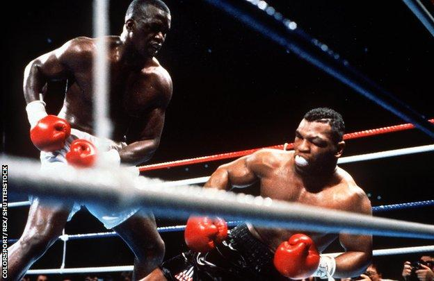 James (Buster) Douglas knocks out Mike Tyson in Tokyo in 1990