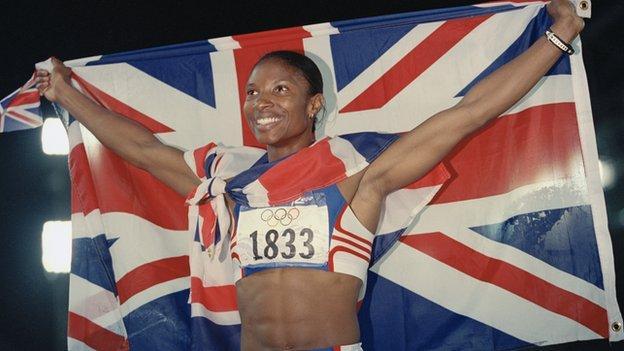 Denise Lewis celebrates winning gold