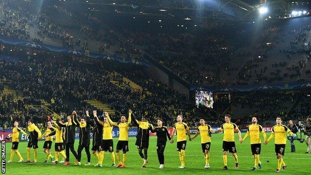 Borussia Dortmund celebrate making Champions League history