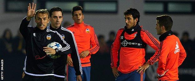 Gary and Phil Neville take training at Valencia on Monday