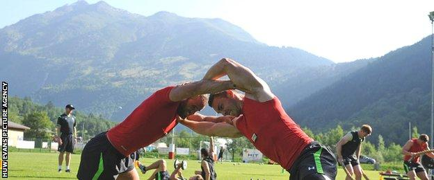 Jamie Roberts and George North grapple during Wales training in the Swiss Alps