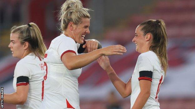 Ella Toone celebrates with Millie Bright