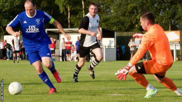 Former Glenavon and Ballymena forward James Costello bears down on goal for Rathfriland Rangers
