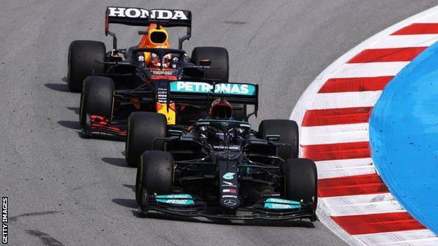 Lewis Hamilton passes Max Verstappen